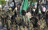 Terrorists from the military wing of the Hamas terror group take part in a parade against Israel in Gaza City on July 25, 2017. (AFP Photo/Mahmud Hams)