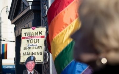 This file photo taken on May 17, 2017 shows people holding up signs during a celebration for Chelsea Manning in the Castro District of San Francisco, California during a celebration for Manning's release. (AFP/Josh Edelson)