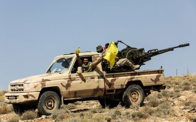 A picture taken on July 26, 2017 during a tour guided by the Lebanese terror group Hezbollah shows its members manning an anti-aircraft gun mounted on a pick-up truck in a mountainous area around the Lebanese town of Arsal along the border with Syria. (AFP Photo/Anwar Amro)