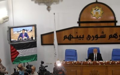 Hamas' MP and head of the parliament in Gaza City Ahmad Bahar (R) chairs a  Palestinian legislative Council meeting in Gaza City as exiled former senior Fatah member Mohammed Dahlan attends it through video conference from the United Arab Emirates on July 27, 2017. ( AFP PHOTO / SAID KHATIB)