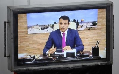 Exiled former senior Fatah member Mohammed Dahlan attends a Palestinian Legislative Council meeting in Gaza City through video conference from the United Arab Emirates on July 27, 2017. (AFP PHOTO / SAID KHATIB)