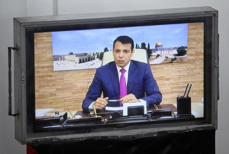 Exiled former senior Fatah member Mohammed Dahlan attends a Palestinian legislative Council meeting in Gaza City through video conference from the United Arab Emirates on July 27, 2017 following developments at the Al-Aqsa Mosque compound. (AFP PHOTO / SAID KHATIB)