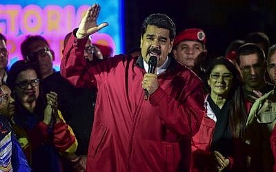 Venezuelan president Nicolas Maduro celebrates the results of the 'Constituent Assembly' elections in Caracas, on July 31, 2017. (AFP Photo/Ronaldo Schemidt)