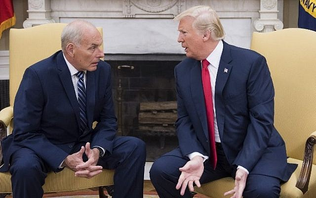 US President Donald Trump (R) speaks with newly sworn-in White House Chief of Staff John Kelly at the White House in Washington, DC, on July 31, 2017.  (AFP PHOTO / JIM WATSON)