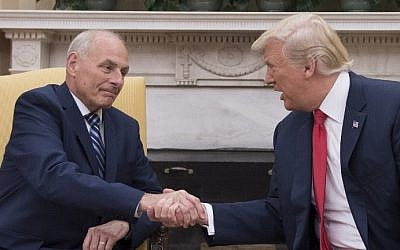US President Donald Trump (R) shakes hands with newly sworn-in White House Chief of Staff John Kelly at the White House in Washington, DC, on July 31, 2017. (AFP Photo/Jim Watson)