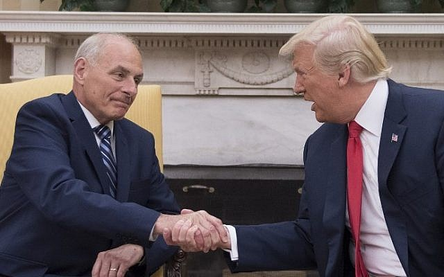 US President Donald Trump (R) shakes hands with newly sworn-in White House Chief of Staff John Kelly at the White House in Washington, DC, on July 31, 2017. (AFP PHOTO / JIM WATSON)
