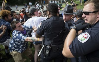 Officers clash with counter protesters after the Ku Klux Klan staged a protest on July 8, 2017 in Charlottesville, Virginia. (Chet Strange/Getty Images/AFP)