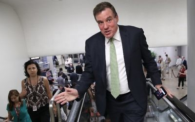 Sen. Mark Warner (D-VA), vice chairman of the Senate Select Committee on Intelligence, speaks to reporters while walking to a vote on the Senate floor at the U.S. Capitol July 12, 2017 in Washington, DC. (Win McNamee/Getty Images/AFP)