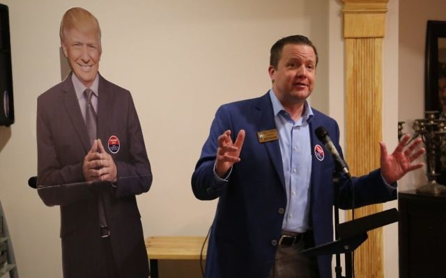 Corey Stewart, then co-chair of Donald Trump's 2016 presidential campaign in Virginia, addresses Trump supporters in a Northern Virginia home on Feb. 1, 2016 for an Iowa caucus watch party. (Eric Cortellessa/Times of Israel)
