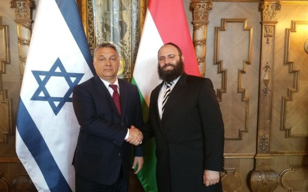 Hungarian Prime Minister Viktor Orban shakes hands with Rabbi Menachem Margolin on July 6, 2017. (European Jewish Association)