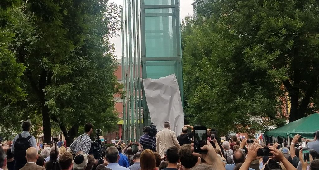 A replacement panel is unveiled at the New England Holocaust Memorial in Boston, Massachusetts, following an act of vandalism in which one of the glass panels was shattered, July 11, 2017 (Matt Lebovic/The Times of Israel)