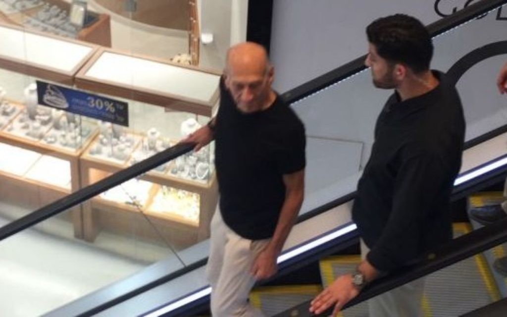 Former prime minister Ehud Olmert is seen shopping at TLV Fashion Mall in Tel Aviv on July 2, 2017, hours after being paroled from Matisyahu Prison. (courtesy)