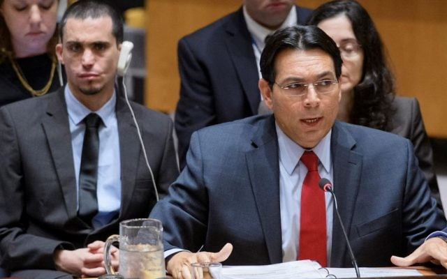 Israel's Ambassador to the UN Danny Danon speaks to the UN Security Council on July, 25, 2017, as terror victim Oran Almog sits behind him. (UN Photo/Manuel Elias via Israel's mission to the UN)
