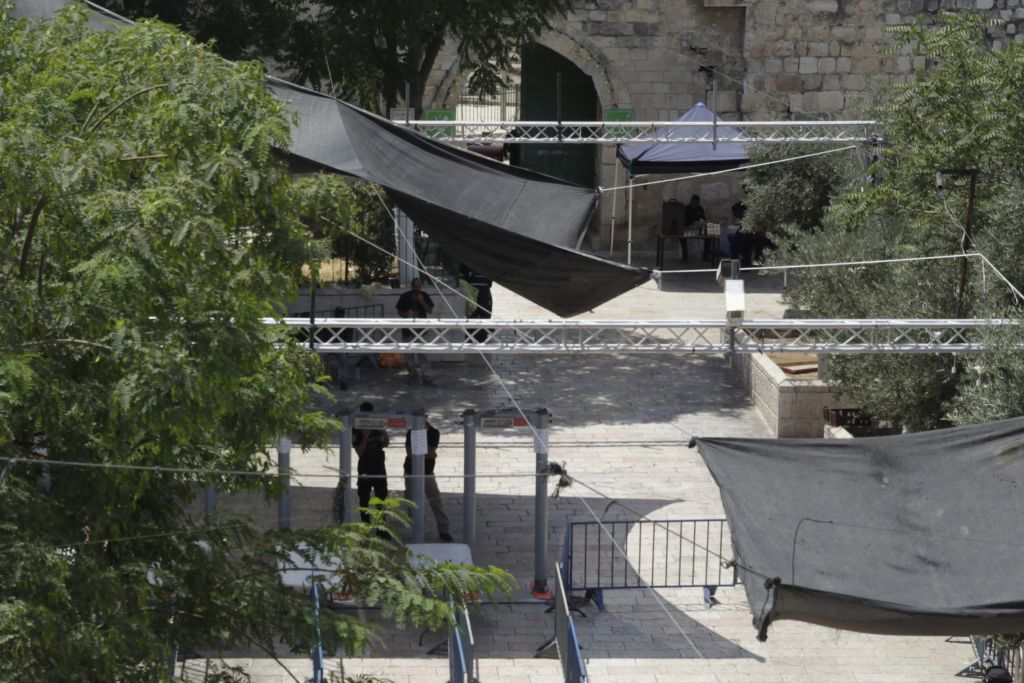 Israeli border police officers stand guard near newly installed cameras at the entrance to the Temple Mount in Jerusalem's Old City, Sunday, July 23, 2017. (AP Photo/Mahmoud Illean)