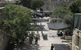 Israeli border police officers stand guard near newly installed cameras at the entrance to the Temple Mount in Jerusalem's Old City, July 23, 2017. (AP Photo/Mahmoud Illean)