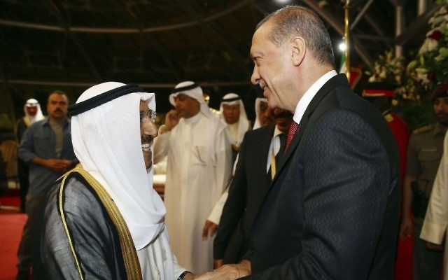 Turkey's President Recep Tayyip Erdogan, right, walks with Emir of Kuwait Sheikh Sabah Al Ahmad Al Sabah, prior to their meeting in Kuwait City, Kuwait, on July, 23, 2017. (Presidency Press Service/Pool Photo via AP)
