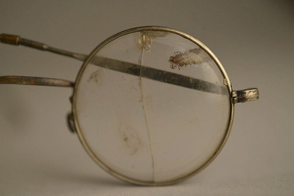 This photo made available by the Aushwitz Museum on Wednesday, July 26, 2017 shows a pair of glasses that once belonged to a person who perished at the Nazi German death camp. (Pawel Sawicki/Aushwitz Museum via AP)