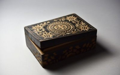 This photo made available by the Aushwitz Museum on Wednesday, July 26, 2017 shows a wooden box made by Polish Auschwitz inmate Brinoslaw Czech. (Pawel Sawicki/Aushwitz Museum via AP)