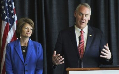 In this May 31, 2017, photo, Interior Secretary Ryan Zinke, right, with US Sen. Lisa Murkowski, R-Alaska, speaks during a news conference in Anchorage, Alaska. (AP Photo/Mark Thiessen)