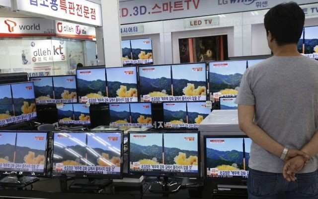 In this July 6, 2017 file photo, a man watches TV screens in an electronics shop showing a news program's report on North Korea's missile firing in Seoul, South Korea. (AP Photo/Ahn Young-joon, File)