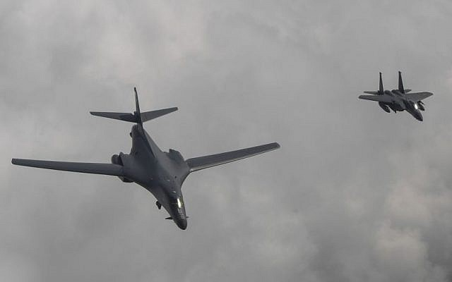 Illustrative: A US Air Force B-1B bomber, left, flies with a South Korean fighter jet F-15K over the Korean Peninsula, South Korea, Sunday, July 30, 2017 (South Korea Defense Ministry via AP)