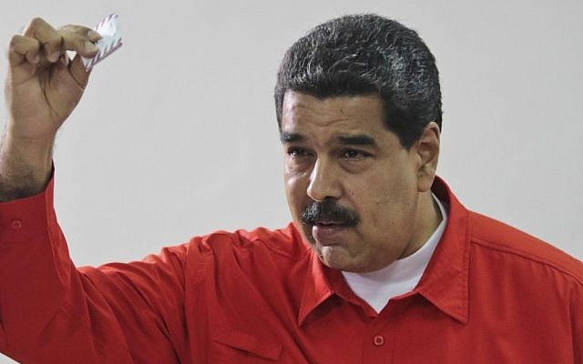 Venezuela's President Nicolas Maduro shows his ballot after casting a vote for a constitutional assembly in Caracas, Venezuela on Sunday, July 30, 2017 (Miraflores Press Office via AP)