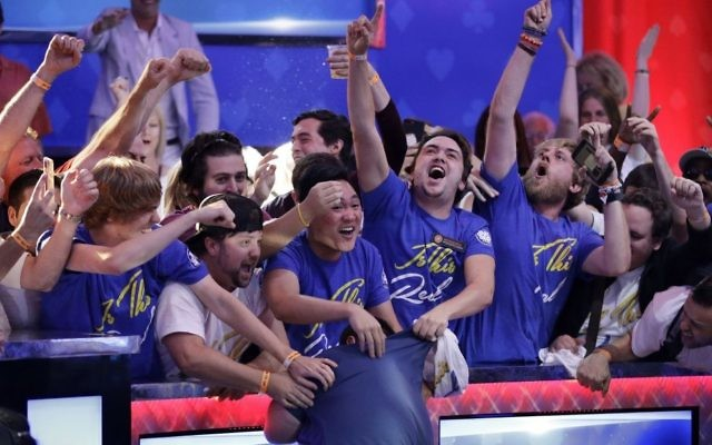 Fans celebrate after Scott Blumstein, bottom center, won the World Series of Poker main event, Sunday, July 23, 2017, in Las Vegas. (AP Photo/John Locher)