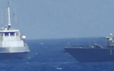 Illustrative: This handout image provided Tuesday, July 25, 2017, from the US Navy purports to show an Iranian vessel making a close approach to a US coastal patrol ship USS Thunderbolt, right. (US Navy via AP)