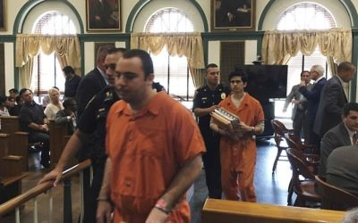 Anthony Graziano and Aakash Dalal are led from the courtroom after their sentencing, Friday, July 28, 2017 in Hackensack, NJ. Graziano and Dalal have been sentenced to 35 years in prison for terrorizing a group of Jewish communities in New Jersey. Prosecutors say they firebombed two synagogues, threw a Molotov cocktail into the home of a rabbi and also spray painted anti-Semitic graffiti at two other synagogues. (Allison Pries/The Record via AP, Pool)