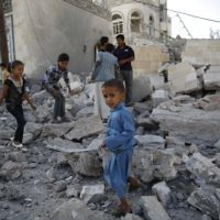 Children play amid the rubble of a house destroyed by a Saudi-led airstrike in Sana'a, Yemen, September 8, 2015. (AP Photo/Hani Mohammed, File)