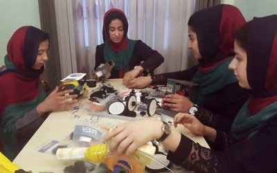 Teenagers from the Afghanistan Robotic House, a private training institute, practice at the Better Idea Organization center, in Herat, Afghanistan on July 6, 2017. (AP/Ahmad Seir, File)