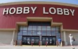 Customers walk to a Hobby Lobby store in Oklahoma City, June 30, 2014. (AP Photo/Sue Ogrocki)