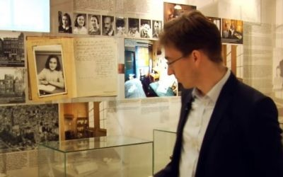Screen capture from video of Patrick Siegele, director of the Anne Frank Zentrum, at the museum in Berlin. (YouTube/Anne Frank Zentrum)