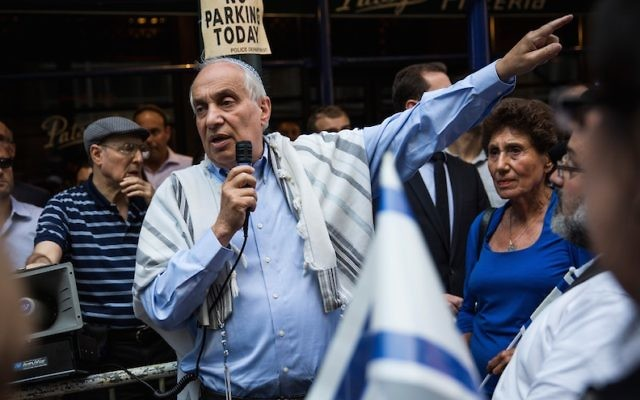 Rabbi Avi Weiss leading a vigil and march in New York City in remembrance of the three Israeli boys who were kidnapped and killed in the West Bank days earlier, June 30, 2014. (Andrew Burton/Getty Images via JTA)