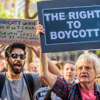 Illustrative image of demonstrators outside the offices of New York Gov. Andrew Cuomo protesting his executive order calling for New York companies to divest from organizations that support the BDS movement, June 9, 2016. (Erik McGregor/Pacific Press/LightRocket/Getty Images via JTA)