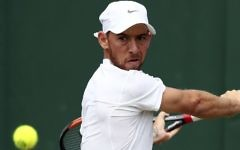 Israel's Dudi Sela returns to Bulgaria's Grigor Dimitrov during their Men's Singles Match on day six of the Wimbledon Tennis Championships at The All England Lawn Tennis and Croquet Club, in London, Saturday, July 8, 2017. (Gareth Fuller/PA via AP)