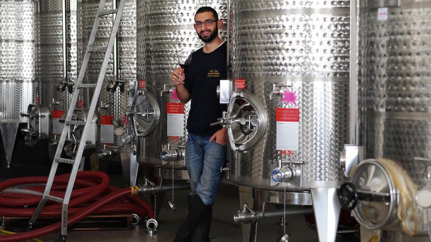 Canaan Khoury posing in a promotional photo at his Taybeh Winery in the West Bank. (Courtesy of Taybeh Winery via JTA)