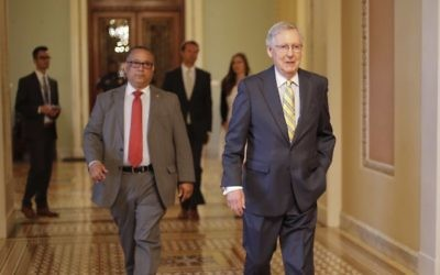 Senate Majority Leader Mitch McConnell of Kentucky walks to his office on Capitol Hill in Washington Thursday, July 13, 2017. (AP Photo/Pablo Martinez Monsivais)