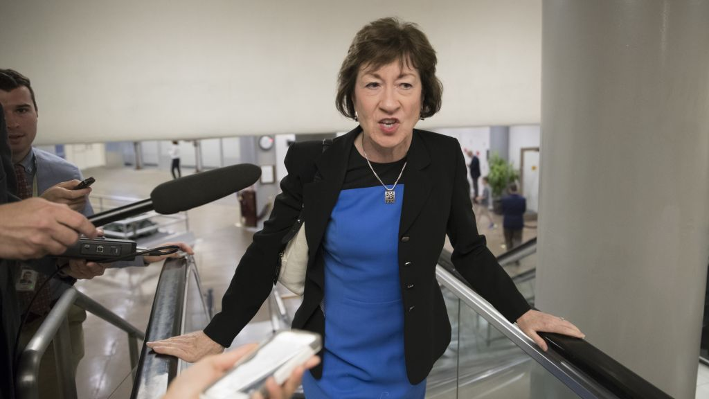 Sen. Susan Collins, R-Maine, heads to the Senate on Capitol Hill in Washington, Thursday, July 13, 2017, for a meeting on the revised Republican health care bill. (AP Photo/J. Scott Applewhite)