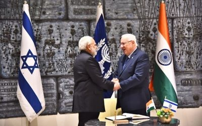 Indian Prime Minister Narendra Modi and President Reuven Rivlin shake hands during a meeting in Rivlin's Jerusalem residence on Wednesday, July 5, 2017 (courtesy)