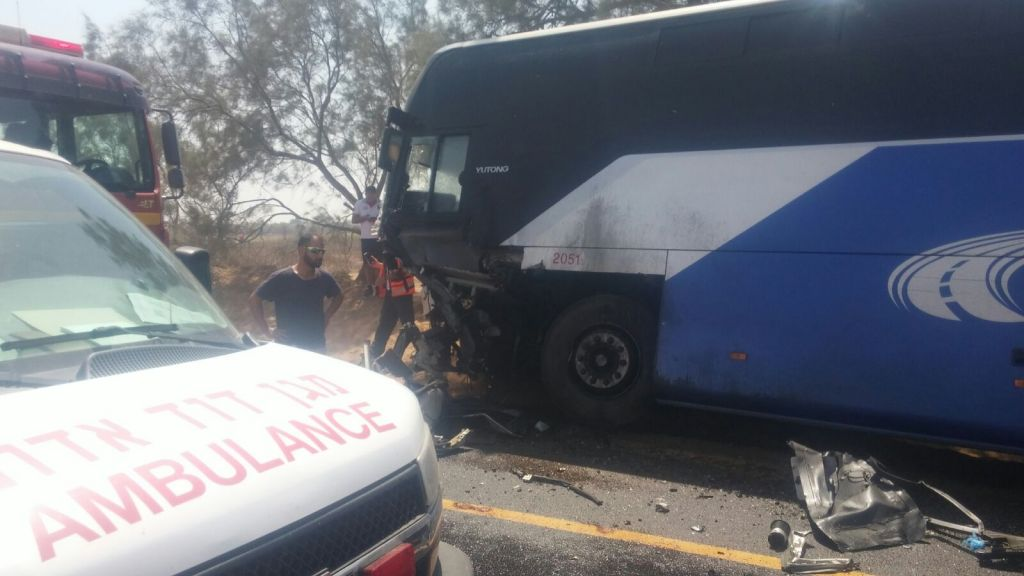 Medics respond to an accident involving a car and a bus, in which an IDF officer was killed, in southern Israel on July 17, 2017. (Magen David Adom)