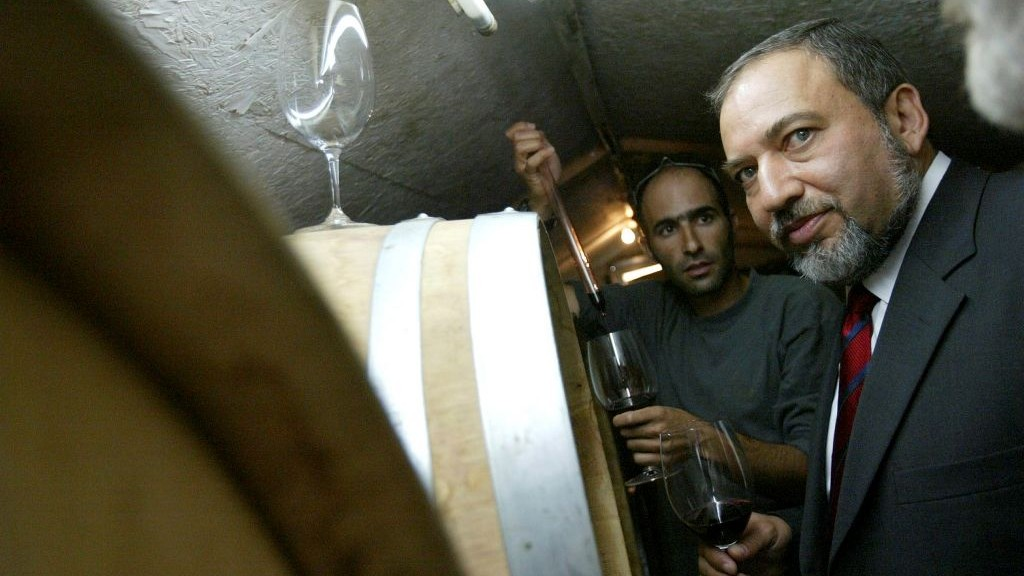 Avigdor Lieberman tastes wine as he tours the winery in Rahelim on October 9. 2007. (Olivier Fitoussi /Flash90)