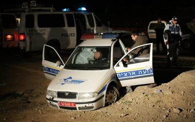 Police inspect a cruiser after the killing of two policemen in the Jordan Valley on  March 15, 2009. (Kobi Gideon/FLASH90)