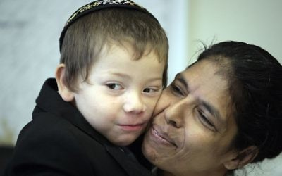 Moshe Holtzberg, an Israeli child whose parents were killed it the Mumbai attack, with his Indian nanny Sandra Samuel on August 18, 2010. (Abir Sultan/Flash 90)