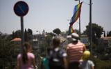 Israelis pass by rainbow flags in Jerusalem ahead of the Jerusalem Pride Parade, on July 31, 2013 (Yonatan Sindel / Flash90)