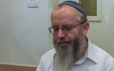 Rabbi Ezra Sheinberg is brought for a court hearing at the Kiryat Shmona Magistrates Court on July 2, 2015. (Basel Awidat/Flash90)