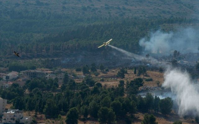 Illustrative photo of firefighter planes extinguishing a fire on July 19, 2015. (Basel Awidat/Flash90)