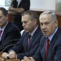 Prime Minister Benjamin Netanyahu (right), Public Security Minister Gilad Erdan (center) and Intelligence and Transportation Minister Yisrael Katz (left) during a cabinet meeting in Jerusalem in 2016.(Amit Shabi/POOL/Flash90)