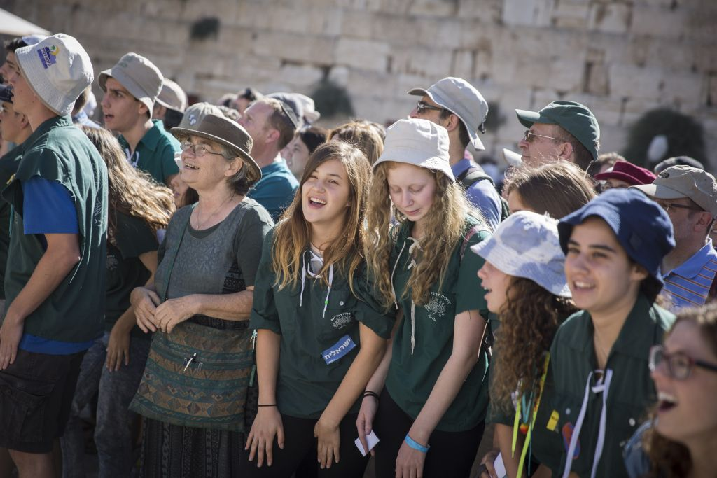 Youth from the Conservative Noam youth movement participate in prayer at the public square in front of the Western Wall, in Jerusalem's Old City, on July 7, 2016. (Hadas Parush/Flash90)