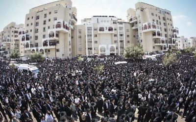 Illustrative: Thousands of ultra-Orthodox Jews attend the funeral of Rabbi Aryeh Finkel, head yeshiva of the Brachfeld branch of the Mir Yeshiva in Modiin Illit, on August 10, 2016. (Shlomi Cohen/Flash90)